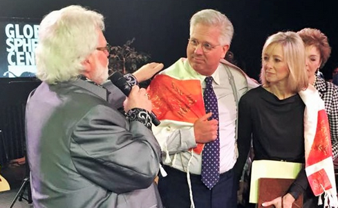 "Chuck Pierce offered Glenn Beck a ""new mantle for the future"" at a ceremony at the Global Spheres Center. Credit: JCORT NEWS"